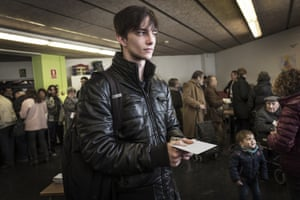 A voter waits to cast his ballot at Fort Pienc school in Barcelona