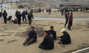 North Korean workers take a break in a street of Pyongyang in 2012.