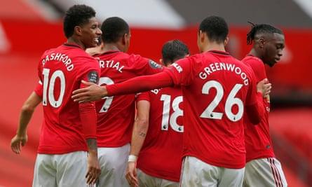 Mason Greenwood congratulates Marcus Rashford after the England international scored a first-half penalty against Bournemouth.