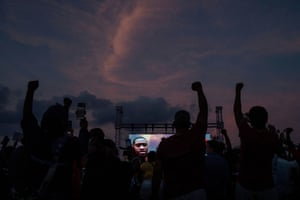 Residents raise hands in solidarity for George Floyd during vigil on his high school football field in Houston.