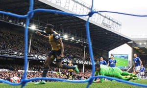 Danny Welbeck rounds Joel Robles to open the scoring for Arsenal.