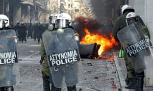 Farmers clash with riot policemen outside the Agriculture Ministry in Athens today