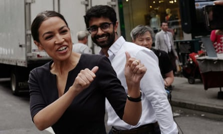 Alexandria Ocasio-Cortez greets a passerby after her victory last week. 'We're in the middle of a movement in this country,' she said after her win.