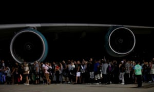British holidaymakers queue by a plane