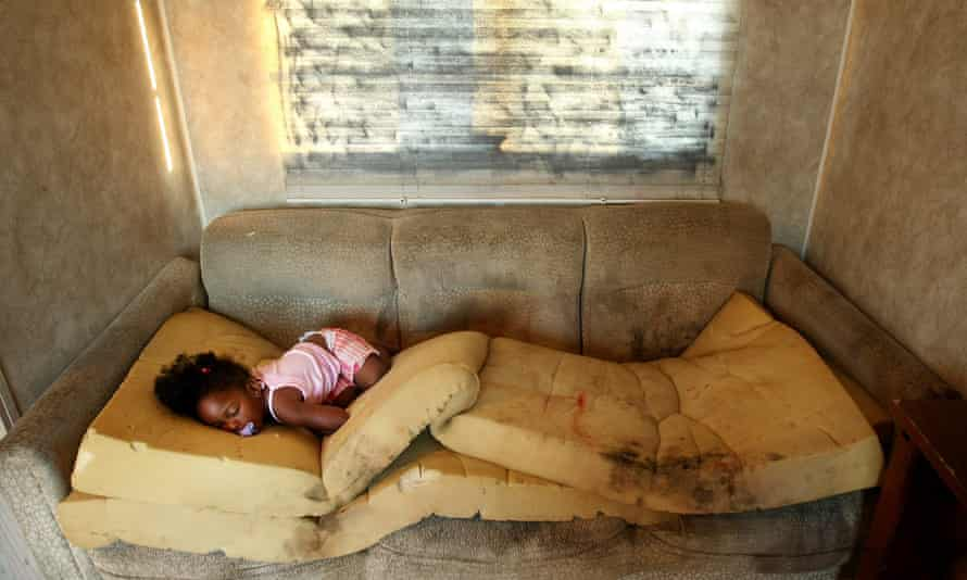 FEMA Deadline For Vacating Trailers Looms For Louisiana<br>PORT SULPHUR, LA - MAY 28: Kailah Smith, 18 months, sleeps on a moldy couch caused by rain leaks in her parents' FEMA trailer just before the family moved out of the trailer to an apartment May 28, 2008 in Port Sulphur, Louisiana. Smith's parents have had to hospitalize her four times with bronchitis since they moved into the trailer a year ago and they say they are sure the trailer is to blame for her illnesses. Doctors fear tens of thousands of children were exposed to dangerous levels of the cancer-causing agent formaldehyde in the post-Katrina FEMA trailers and could have lifelong illnesses. FEMA federal trailer parks that house many Hurricane Katrina victims are set to close May 31, prompting fears that people will be forced into residences they can't afford or will be left homeless. (Photo by Mario Tama/Getty Images)