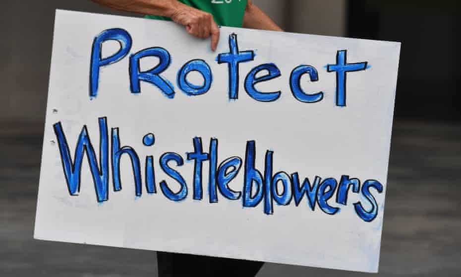 Placard saying 'protect whistleblowers'