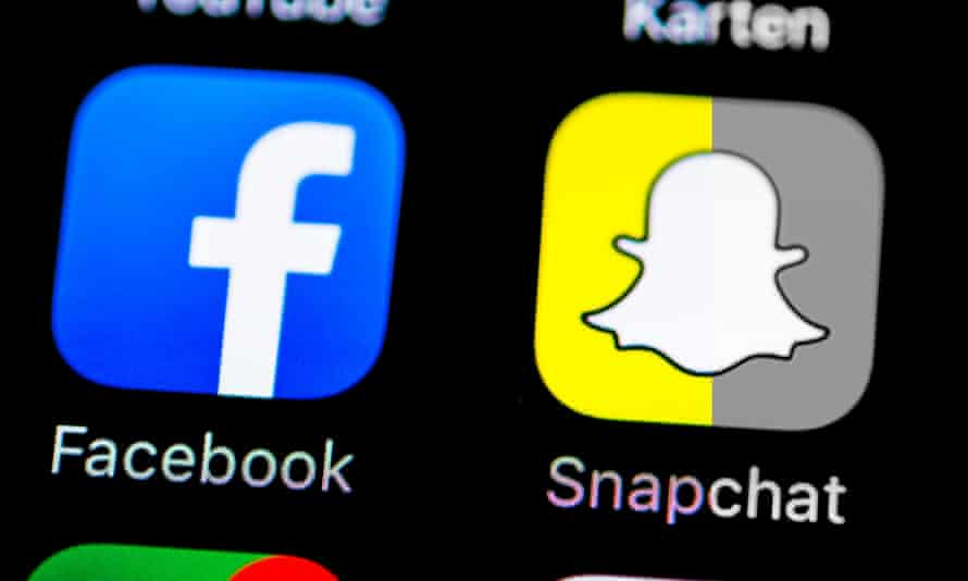 Smartphone screen with SnapChat and Facebook app icons.