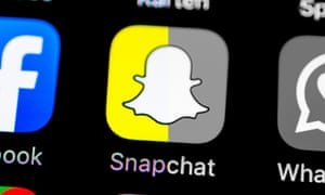 Smartphone screen with Snapchat, WhatsApp, Facebook app icons