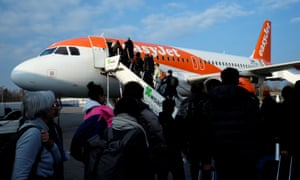 Passengers board the easyJet aircraft from Berlin to Geneva at Schoenefeld airport.