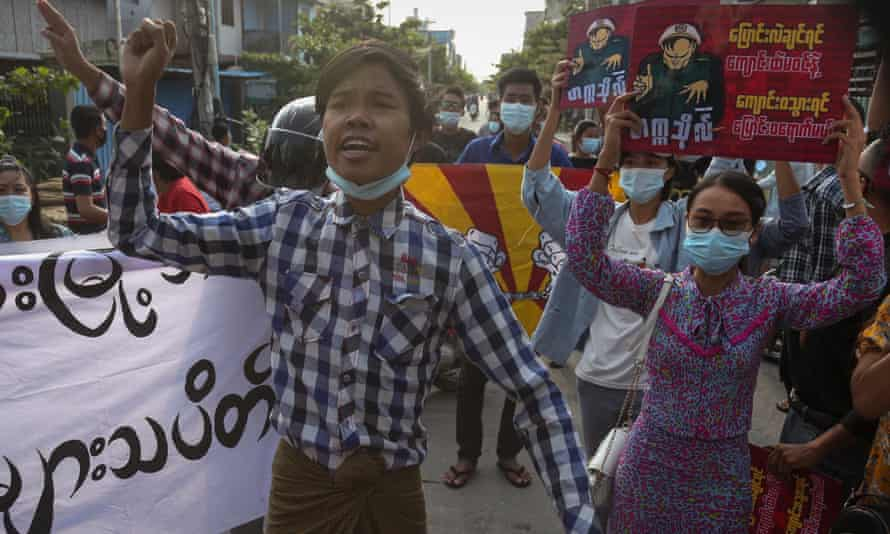 Demonstrators march during an anti-military coup protest in Mandalay, Myanmar, on Wednesday.