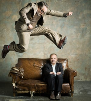 Vic Reeves leaping over a battered old sofa that Bob Mortimer is sitting on