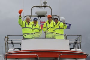 Prime Minister Boris Johnson and the chancellor, Rishi Sunak, onboard a boat on the River Tees at Teesport, UK