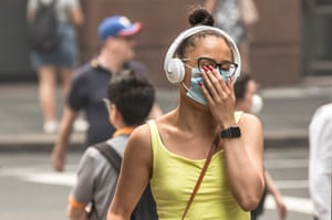 A woman walks through Martin Place wearing a face masks to try and limit the effects of the smoke.