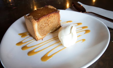 Treacle tart and ice-cream on a plate, at The Cow, Dalbury Lees, UK