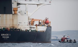 FILES-SPAIN-BRITAIN-SYRIA-IRAN-DIPLOMACY-CONFLICT(FILES) In this file photo taken on July 06, 2019 A ship approaches supertanker Grace 1 off the coast of Gibraltar on July 6, 2019. Gibraltar police have arrested the Indian captain and chief officer of a seized Iranian tanker suspected of breaching EU sanctions by shipping oil to Syria, a spokesman for the Royal Gibraltar Police said on July 11, 2019. - Iran demanded on July 5, 2019 that Britain immediately release an oil tanker it has detained in Gibraltar, accusing it of acting at the bidding of the United States. Authorities in Gibraltar, a British overseas territory on Spain's southern tip at the western entrance to the Mediterranean, said they suspected the tanker was carrying crude to Syria in violation of EU sanctions. (Photo by JORGE GUERRERO / AFP)JORGE GUERRERO/AFP/Getty Images