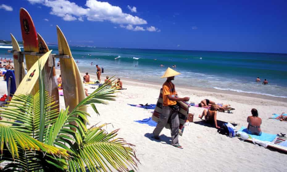 People on Kuta beach in Bali, Indonesia