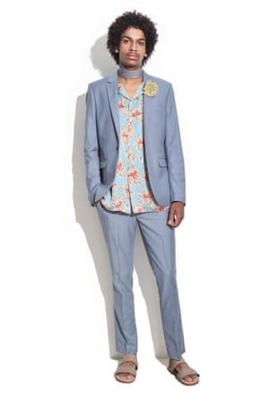 man in blue suit with floral shirt