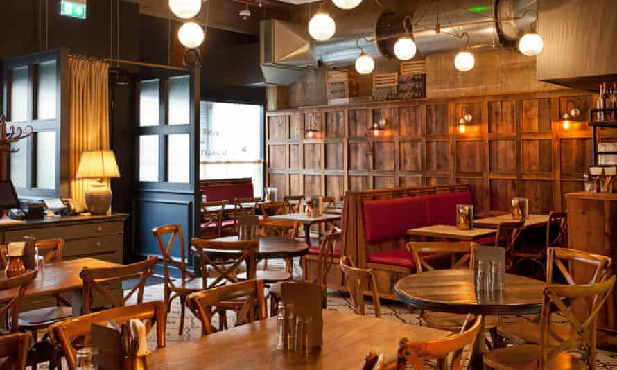 Wooden tables, chairs and pannelling at the Tandoor Chop House