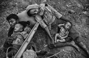 An exhausted family after crossing the Naf river