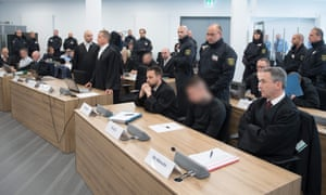 Members of the 'Revolution Chemnitz' group in the courtroom in Dresden.