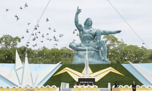 Nagasaki, Japan: Doves fly around the Peace statue during a memorial service to mark the 74th anniversary of the atomic bombing at Peace Memorial Park