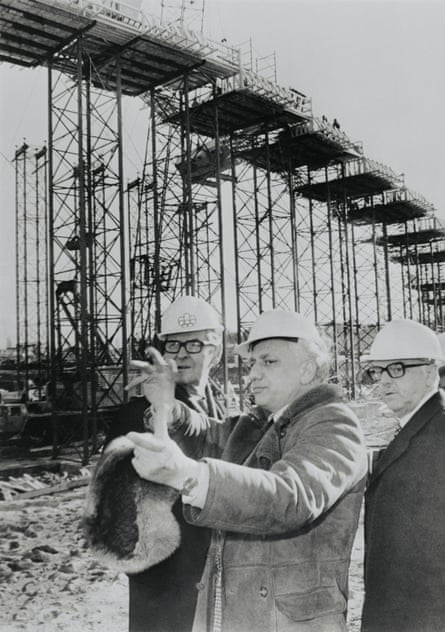 Governor general Jules Leger (left) and mayor Jean Drapeau (right), listen as Roger Taillibert describes the layout of Parc Olympique.