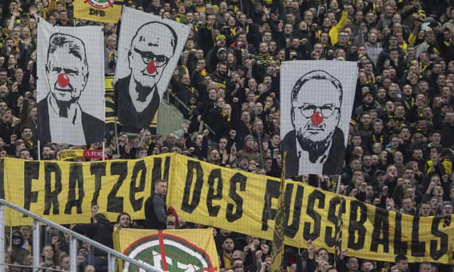 Supporters show protest banners
