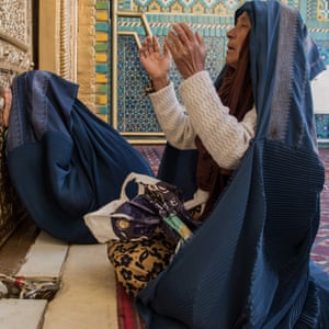 Women pray and cry at the shirne of Hazrat Ali, a holy pilgrimage site for Sunni and Shia Muslims