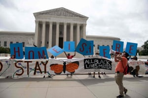 Activists hold a banner in front of the US Supreme Court in Washington, DC, on June 18.