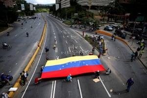 Caracas, Venezuela Demonstrators display a flag