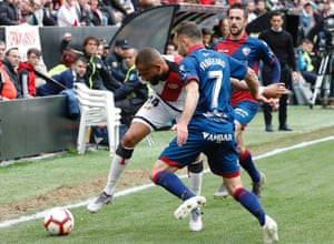 Rayo Vallecano's winger Bebé is harried by Huesca defenders during the 0-0 draw.