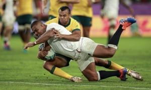 England prop Kyle Sinckler dives over for his side's third try despite a desperate tackle attempt by Australia's Kurtley Beale in their quarter-final at Oita Stadium.