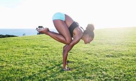 Great, oudoors: a woman practising yoga.