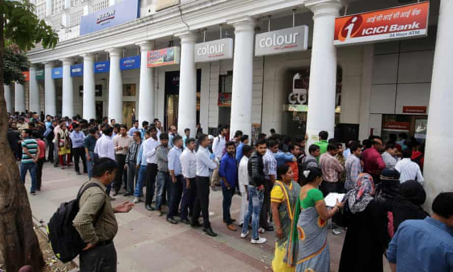 People line up to change old Indian rupee notes outside a bank in New Delhi.