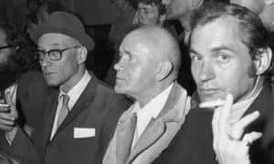 Jean Genet (middle) sitting next to William S Burroughs on a visit the US in the 1960s.