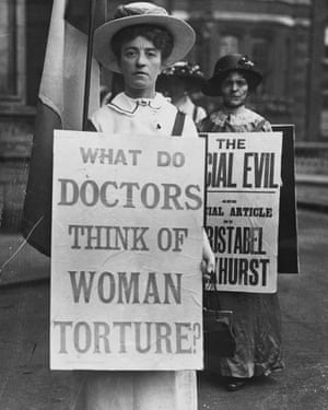 A woman protests outside the Royal Albert Hall, which is hosting the International Congress of Medicine.