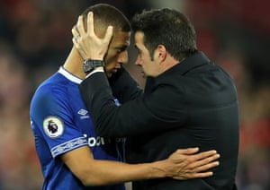Marco Silva consoles Richarlison after the final whistle.