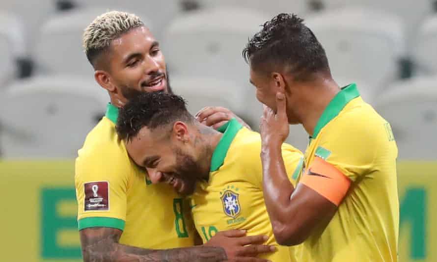 Douglas Luiz with Neymar (centre) and Thiago Silva during Brazil's win over Bolivia last December.