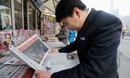 A man reads the Southern Weekly at a newsstand in Beijing
