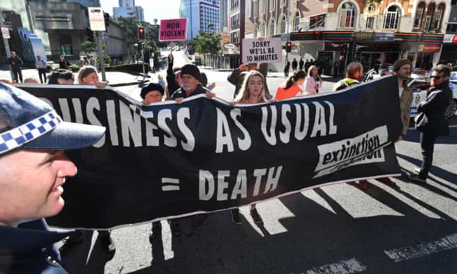 Extinction Rebellion protesters blocking traffic in Brisbane, 15 July 2019.