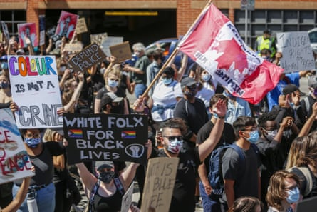 Protesters in Calgary rally against police violence and racism. Activists and historians argue that before change can come, Canadians must first accept a tarnished history.
