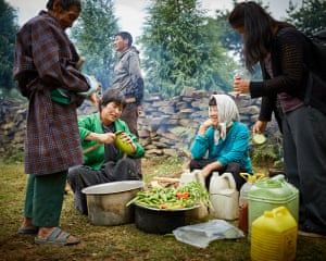 Farmers prepare a picnic during harvest. Over the past nine years, Mountain Hazelnuts has distributed 7m trees and engaged 11,000 farmer households, monasteries, and nunneries.