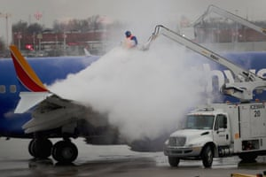 Workers deice a Southwest Airline's aircraft at Midway Airport in Chicago, Illinois.