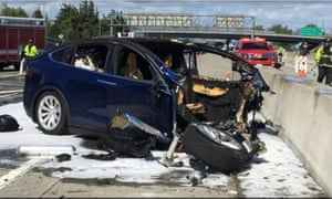 Emergency personnel work a the scene where a Tesla electric SUV crashed into a barrier on US Highway 101 in Mountain View, California.