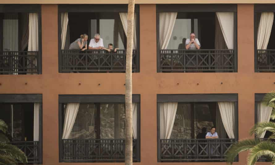 Guests on balconies at the H10 Costa Adeje Palace hotel in Tenerife.