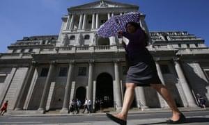 Pedestrians walk past Bank of England