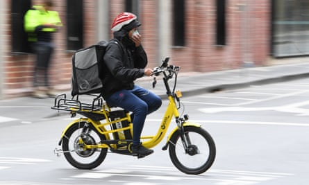 A home food delivery rider wears a mask in Melbourne after Victoria went into shutdown amid the ongoing coronavirus pandemic.