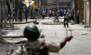 Kashmiri protesters throw stones at Indian police and paramilitary troops in Srinagar
