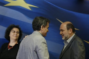 Euclid Tsakalotos, Nadia Valavani, Tryfon Alexiadis<br>Greece's Finance Minister Euclid Tsakalotos, center, is greeted by outgoing Alternate Finance Minister Nadia Valavani, left, and the incoming Tryfon Alexiadis during the hand over ceremony in Athens, Monday, July 20, 2015. Greek banks finally reopened after three weeks of being closed but new austerity taxes meant that most everything was more expensive — from coffee to taxis to cooking oil. (AP Photo/Thanassis Stavrakis)