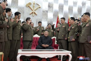Senior military officials pose with commemorative pistols they were given by their leader, Kim Jong-un.